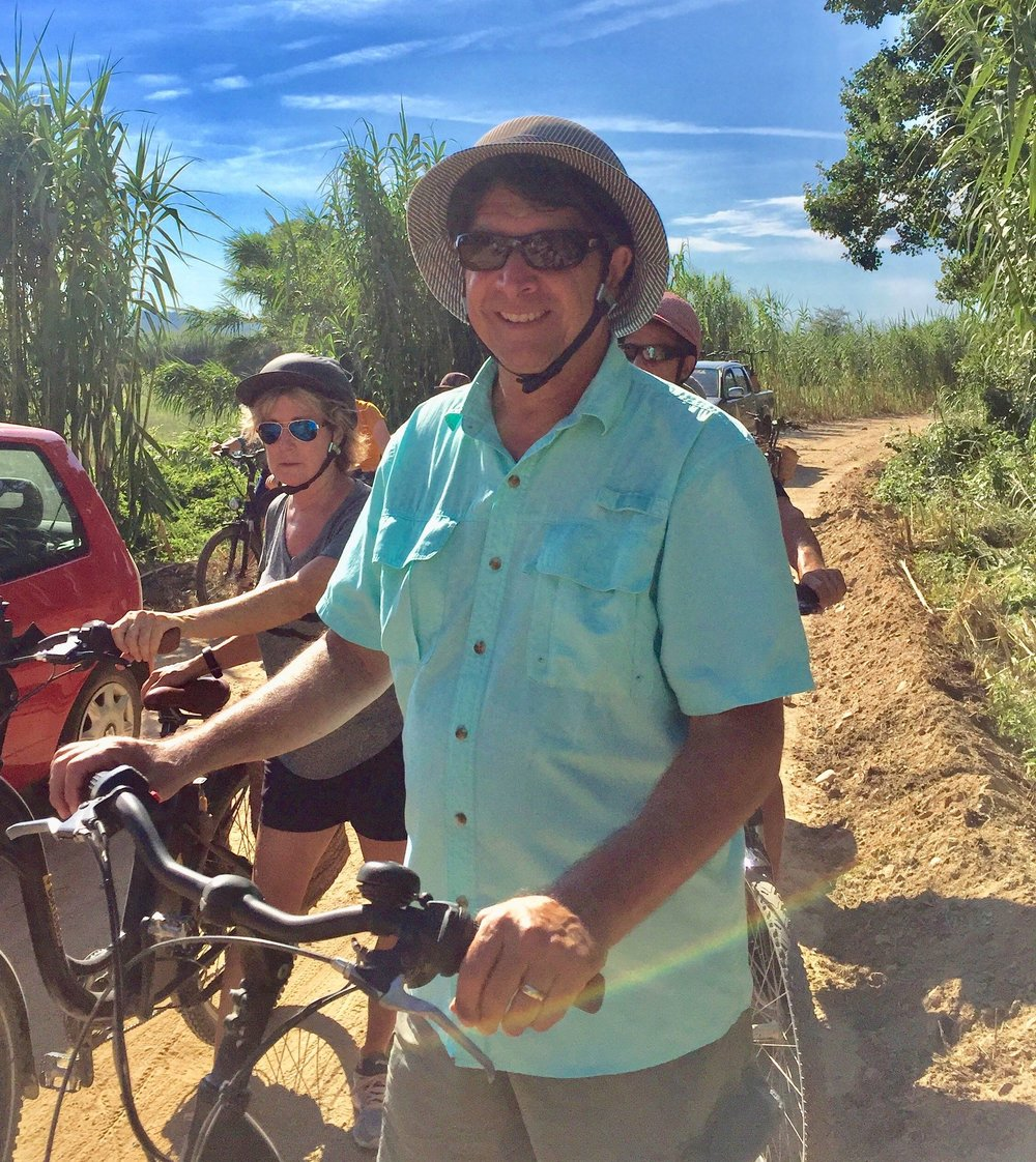 Joe Fairchild, Co-founder of Well Traveled enjoying his Seabourn (luxury cruise line) excursion bike ride to Pals, Spain.