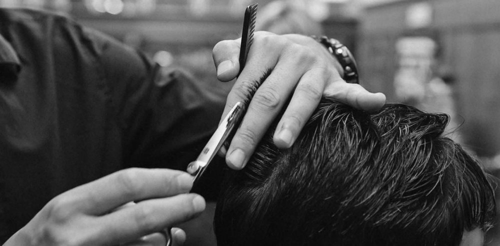 man-cutting-hair-scissors-men-1170x576.jpg