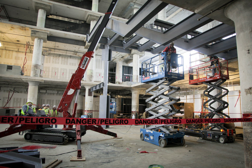 Workers constructing the Concourse Central Atrium stairs.