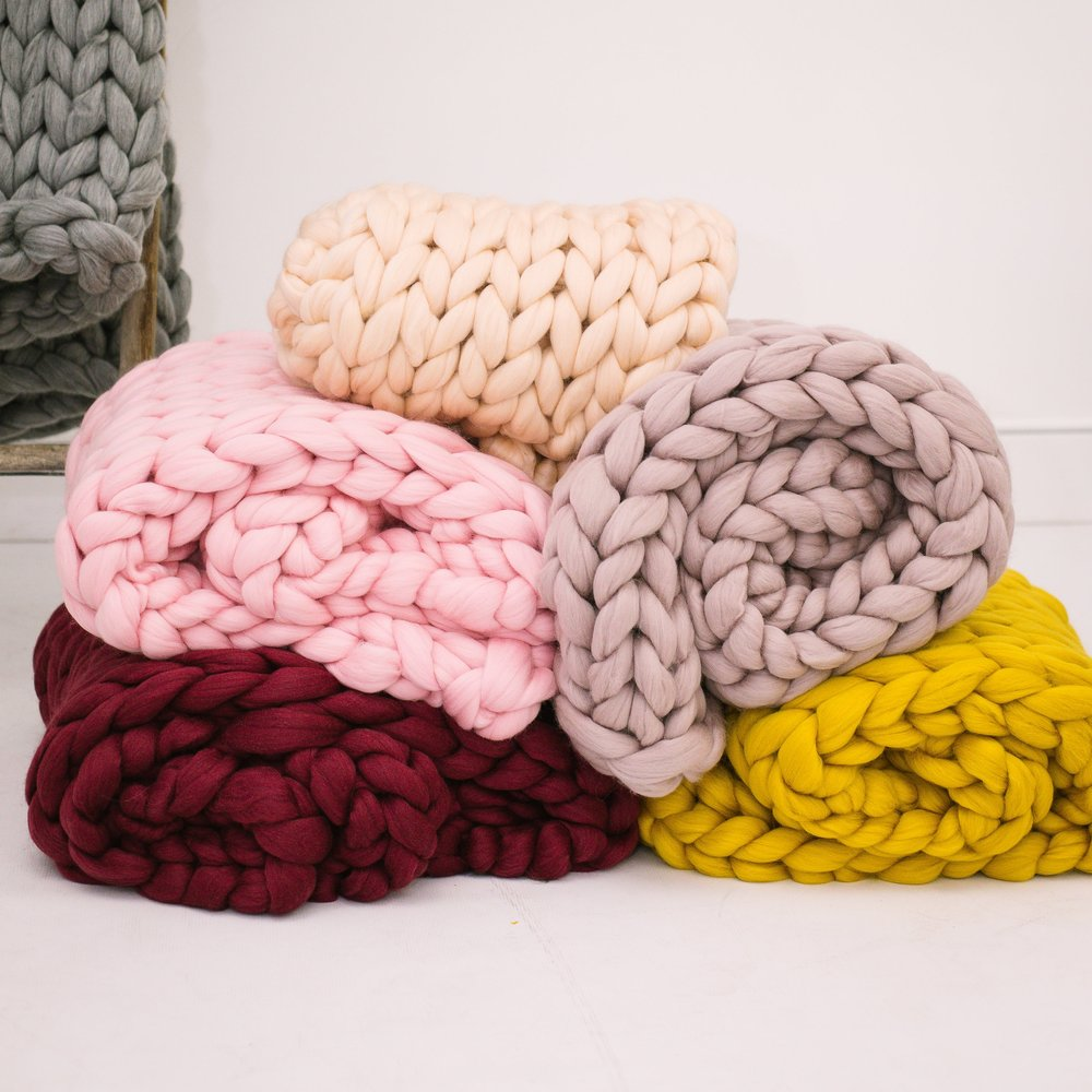 step 9— cozy blankets - No living room can ever have too many cozy blankets!!! So this is obviously a must! Check out our line of cozy SarahLou Co. throws to add some more pops of color to your room.