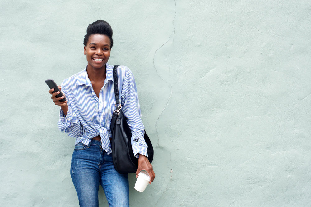 beautiful-black-woman-holding-cellphone-837DMYK.jpg