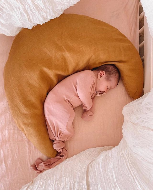 little Frankie sleeping on our sunkissed linen cot sheet 🌞 @amberfillerup