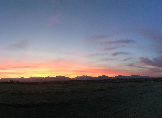 View of the Northern edge of the mountains of #Snowdonia from the office this morning. Red sky in the morning proverb was spot on. #eryri #nofilter #northwales #cymru #mountains #sunrise #landscape