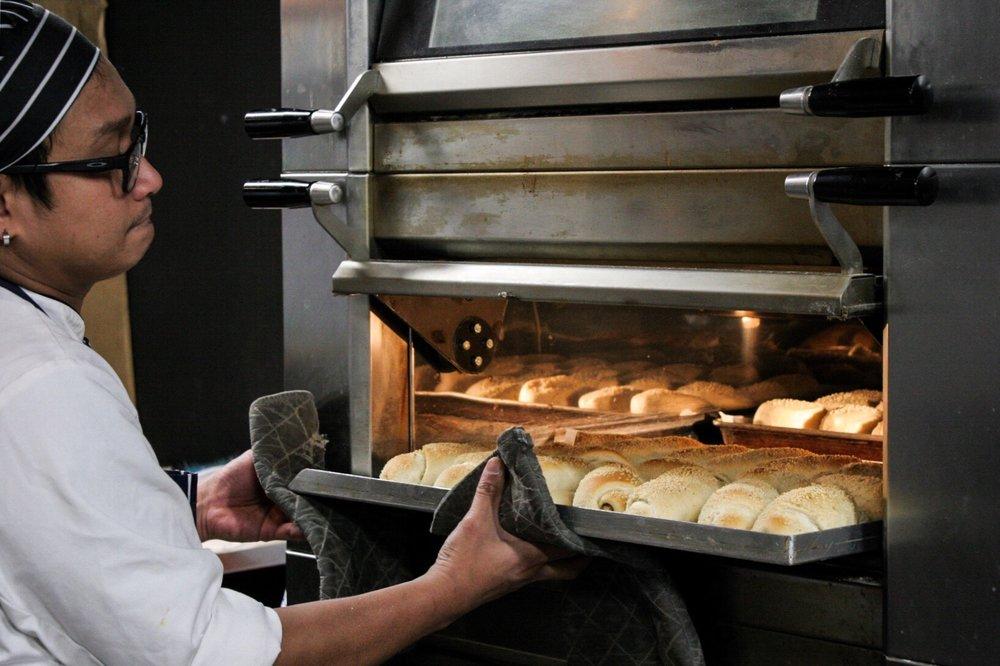 Fresh baked Spanish Bread from Panadero Filipino Bakery