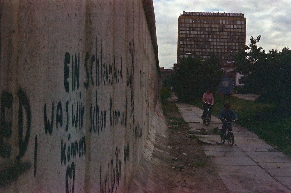 30 + Year old film - Absolute best case scenario for film this old. Customer found numerous pics of a Berlin Wall visit. Notice low contrast, dark subjects, blurred image, added grain, color shifts, but amazing shape for film this old.