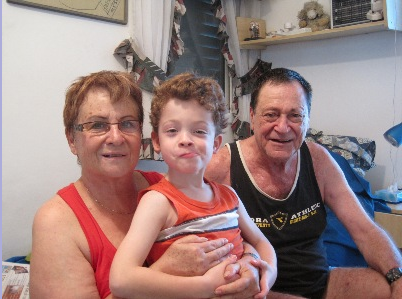 Chava and Oded Teomi with their grandson Omer