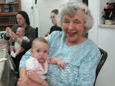 With little Hanni.  Rahelli in the background with her youngest, Moshe
