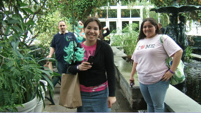 2 girls with a strange orchid in the glasshouse
