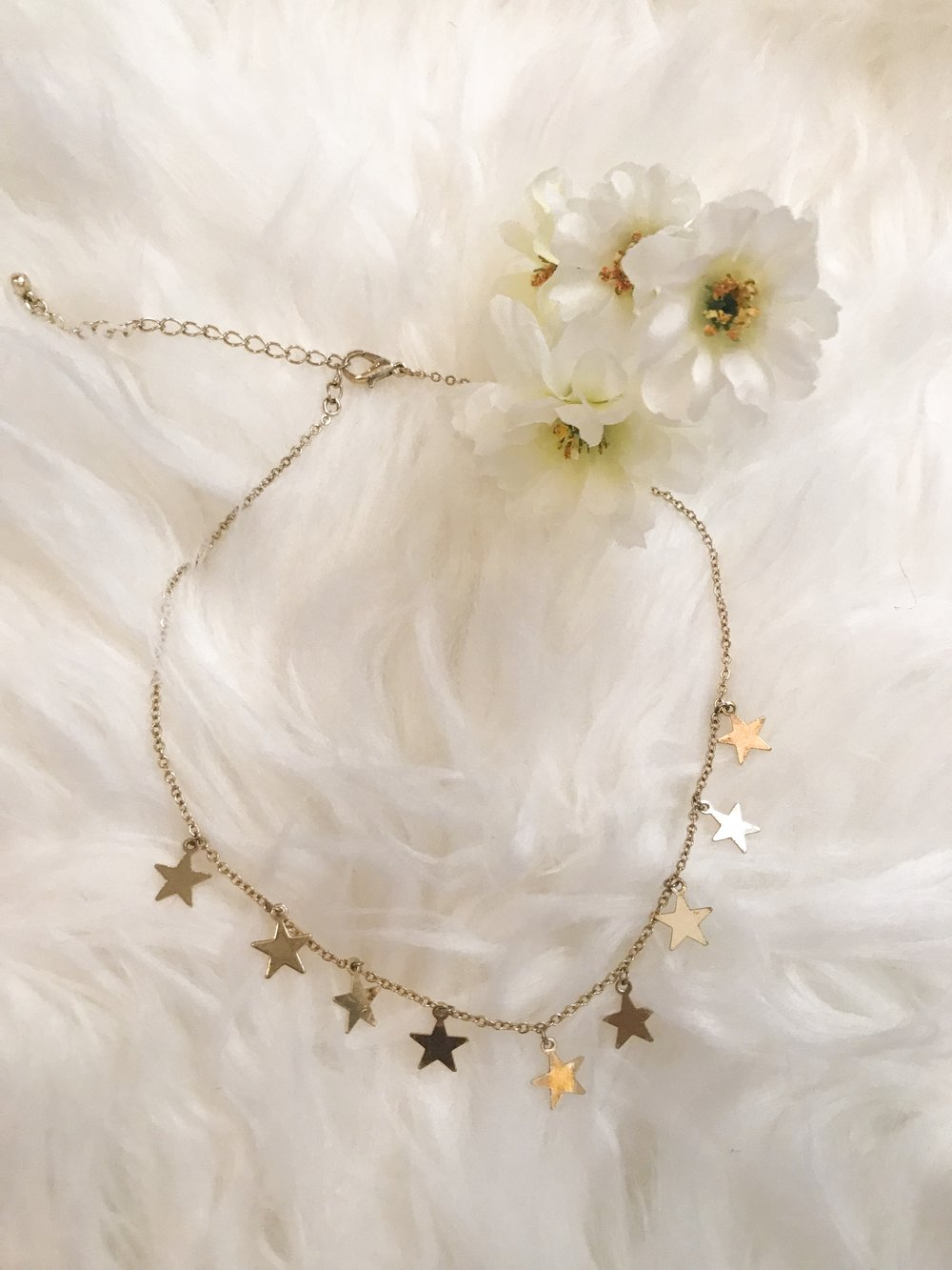 Star Choker $4.90 - Forever 21 - This right here is my most asked about piece of jewelry! Every time I wear it I get compliments on it and asked where it's from! I wear it with almost every outfit! Definitely my favorite choker, and you can't beat that price!