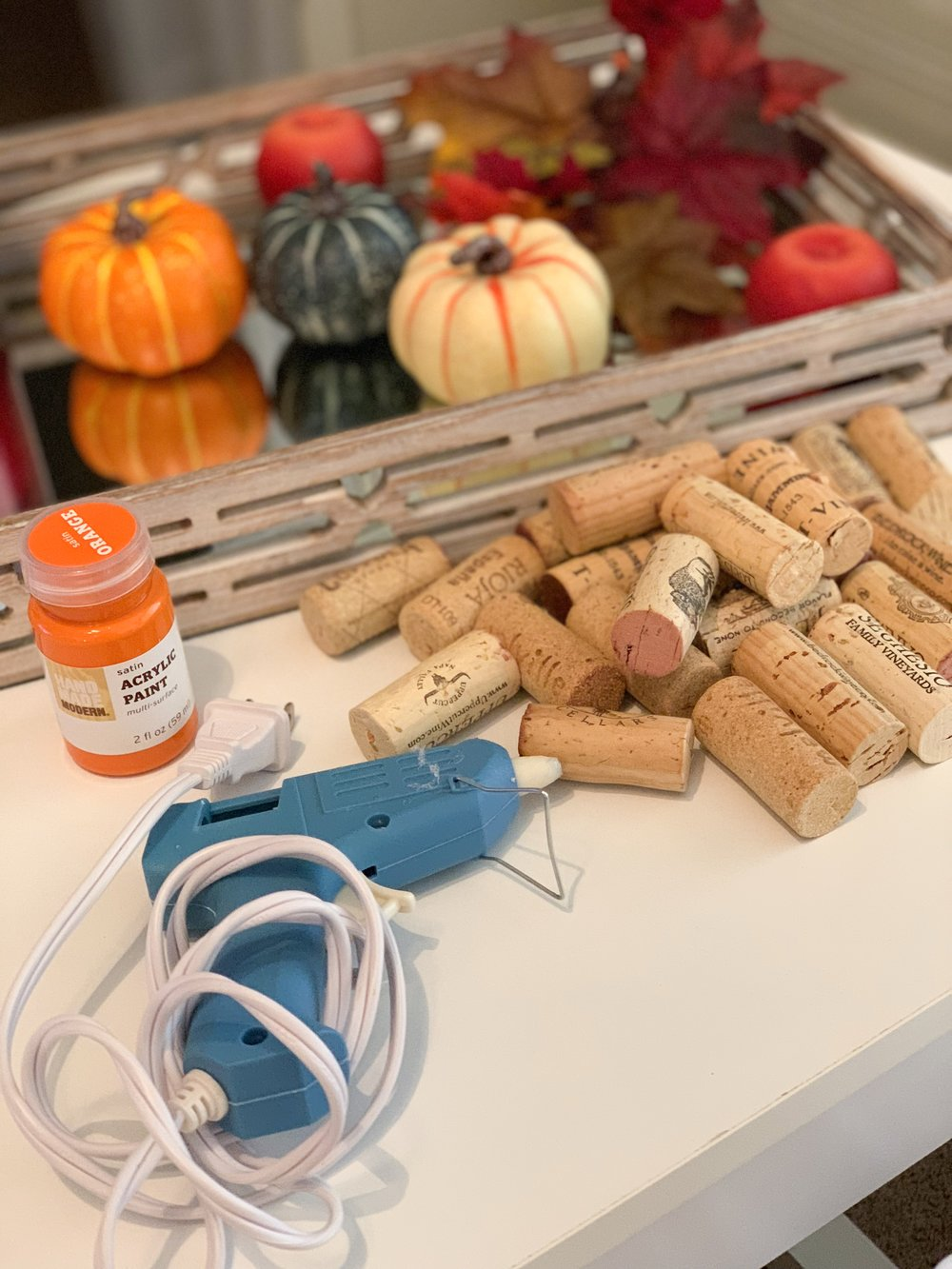 Cork Pumpkin:    Corks    Orange Paint    Hot Glue Gun