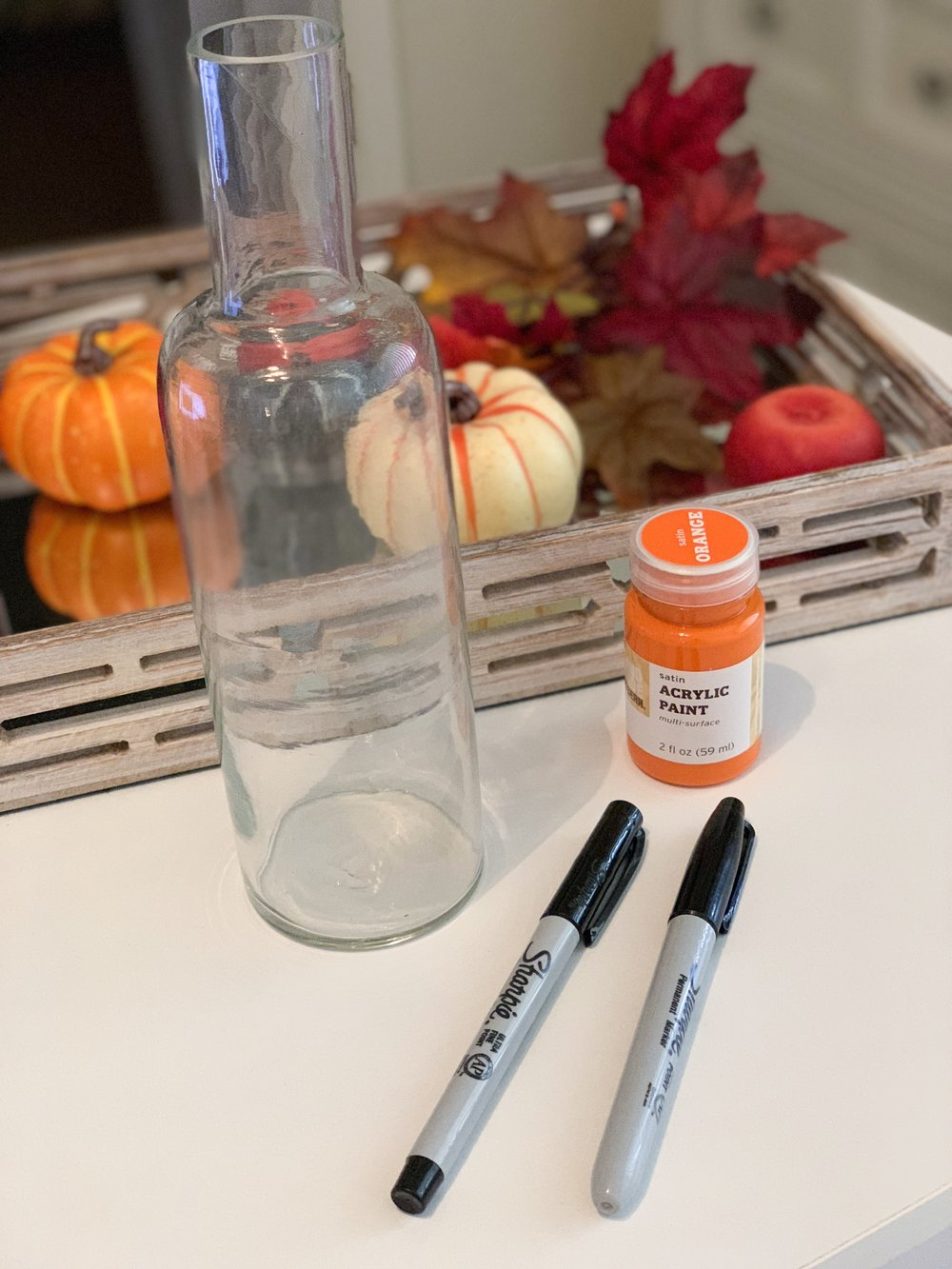 Pumpkin Faced Bottle:    1 Glass Bottle    Orange Paint    Black Sharpie (or black paint)