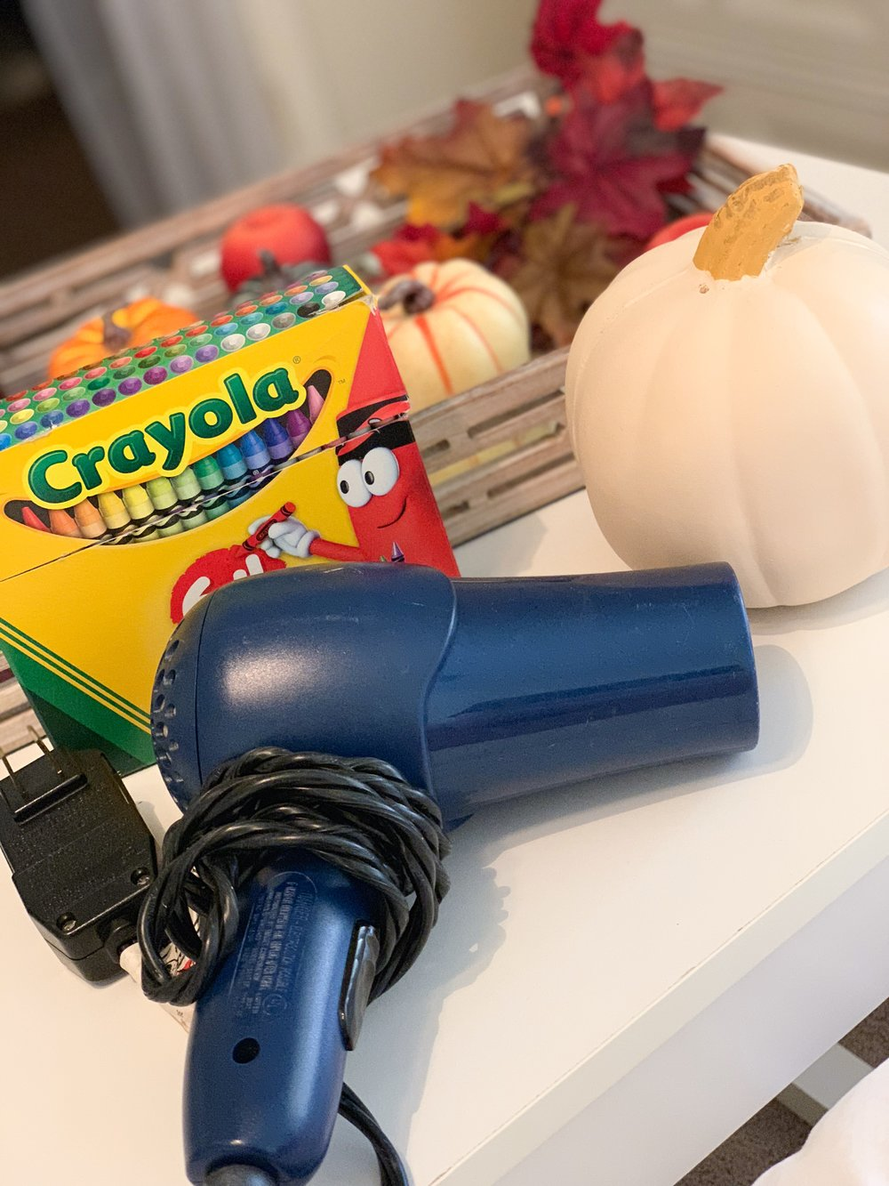 Melted Crayon Pumpkin:    White Pumpkin (real or faux)    Crayola Crayons    Blow Dryer    Glue
