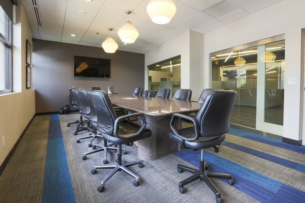 A new conference room features a stone table and glass walls
