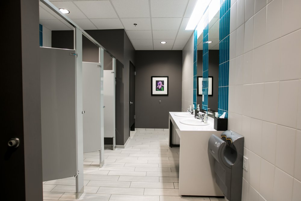 Glass and tile feature prominently in the bathrooms at Power Sales's new office