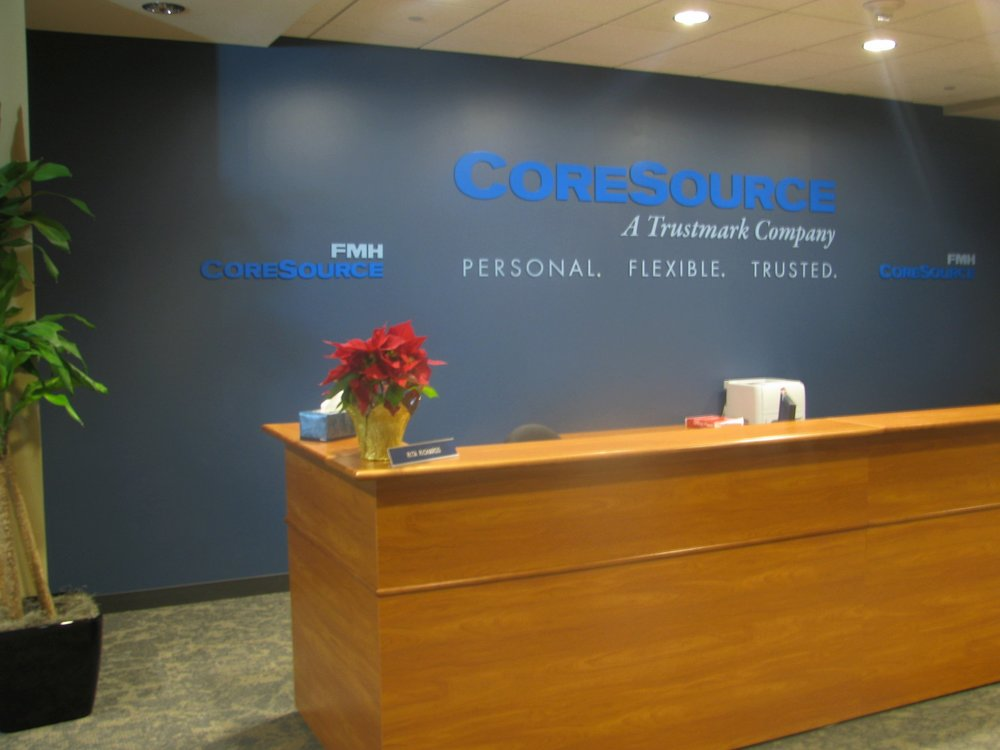 Front desk of CoreSource's remodeled office space at the Sprint Campus