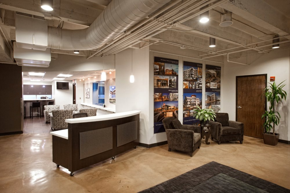 Soft textiles welcome visitors to the lobby space in CBC Real Estate's remodeled Country Club Plaza office