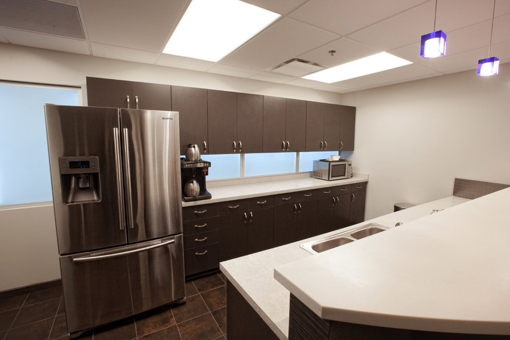 A new kitchen area break room for CBC Real Estate's employees