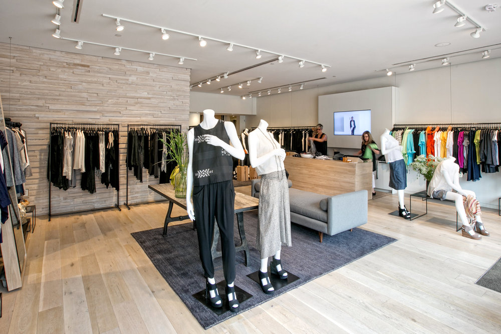 Warm wood and stone create an elegant look for Eileen Fisher's Country Club Plaza retail store remodel