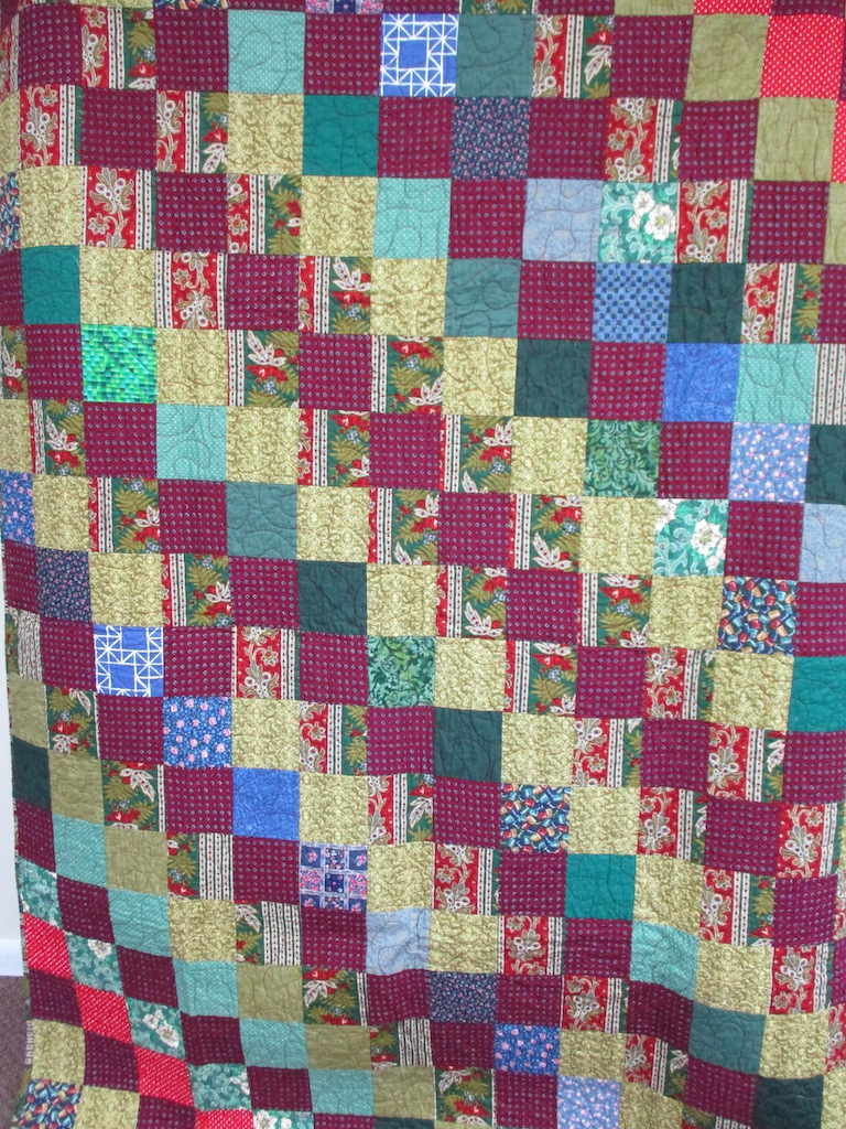 2, CHRISTMAS COMFORTER, 58x76, Pieced and Donated by Eileen Wenger