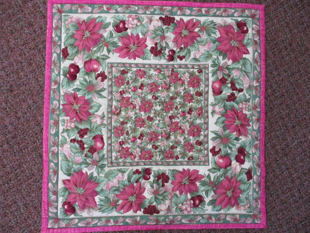 12, POINSETTIAS, 21x22, Quilted and Donated by Mt. Joy Mennonite Sewing Circle