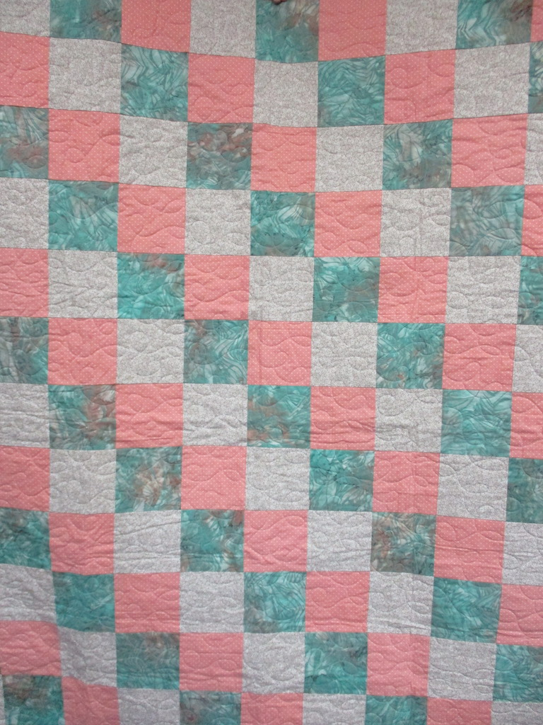 15, SCRAPPY BATIK (machine quilted), 58x76, Pieced by Mildred Groff, Donated by Cumberland Valley Relief Center