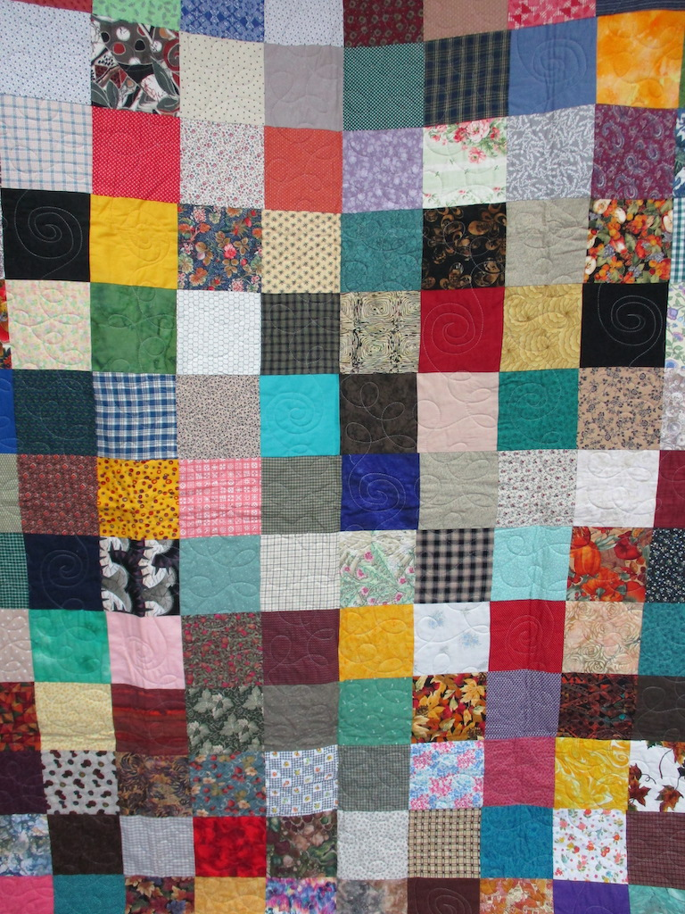 23, SCRAPPY NUMBER TWO (machine quilted), 59x77, Pieced by Mildred Groff, Donated by Cumberland Valley Relief Center