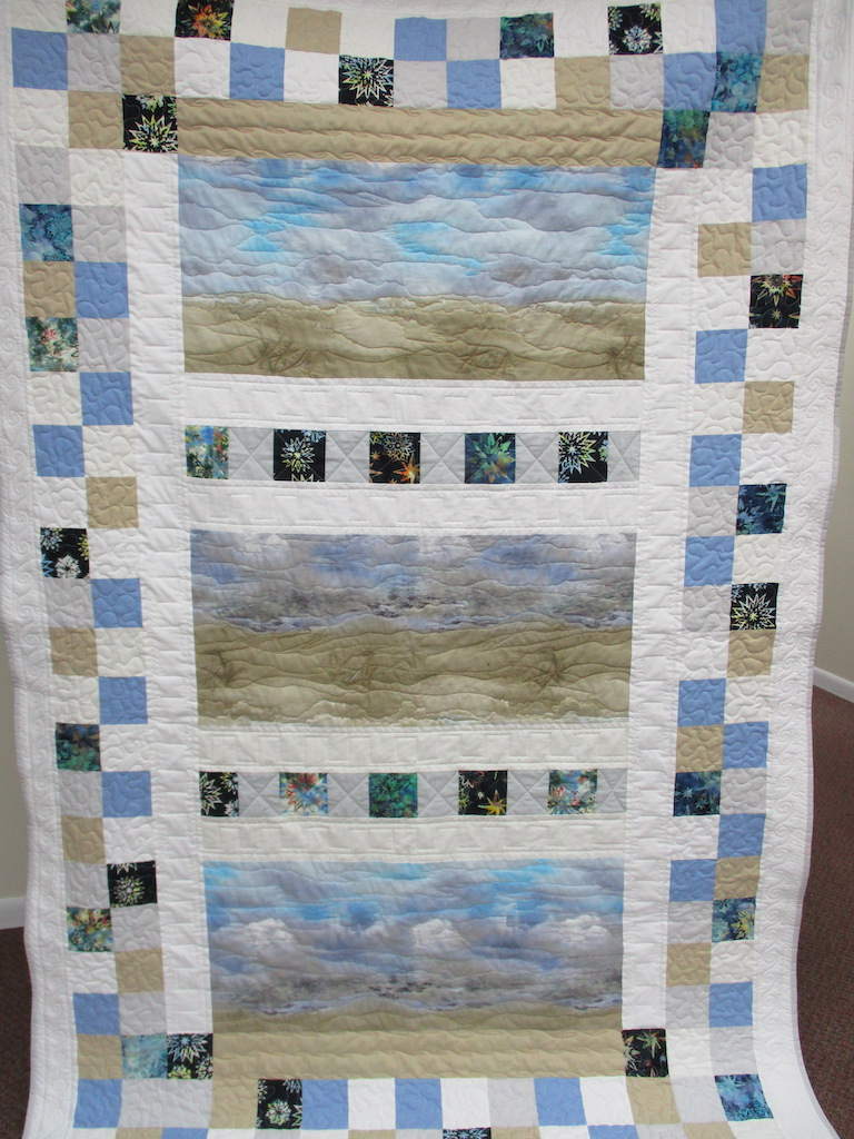 29, SERENITY II (machine quilted, signed and dated), 58x90, Pieced, Quilted and Donated by Ruth Penner