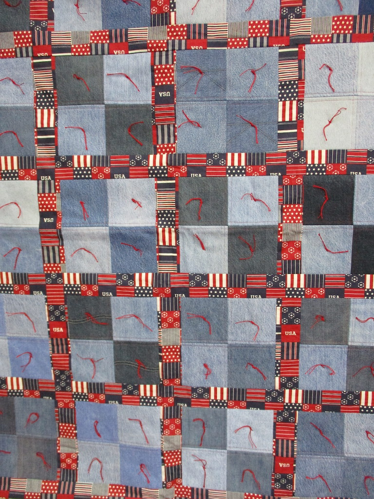 34, PATRIOTIC JEANS COMFORTER, 43x52, Pieced and Donated by Charlotte Jacobs