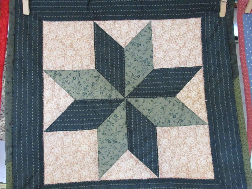 50, LONE STAR (signed and dated), 16x16, Machine quilted, Donated by Cumberland Valley Relief Center