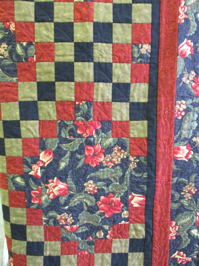 52, BLACK AND RED IRISH CHAIN (signed and dated), 55x55, Pieced and machine quilted by Judith McLean
