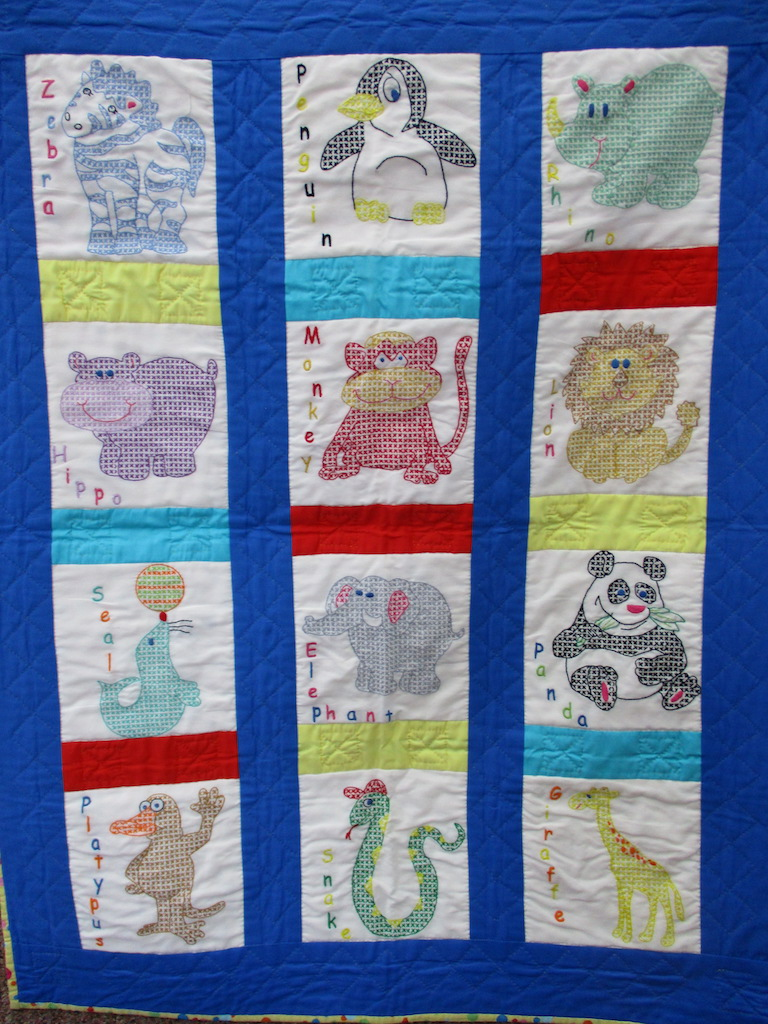 54, FOR THE GRANDCHILDREN (signed and dated), 31x40, Cross stitched, Quilted and Donated by Kimberly Tucker
