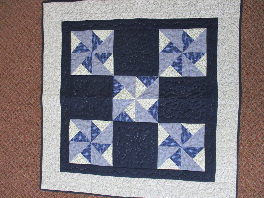 56, DOUBLE PINWHEELS, 39x39, Quilted by Erisman Mennonite Sewing Circle, Donated by A friend of MCC