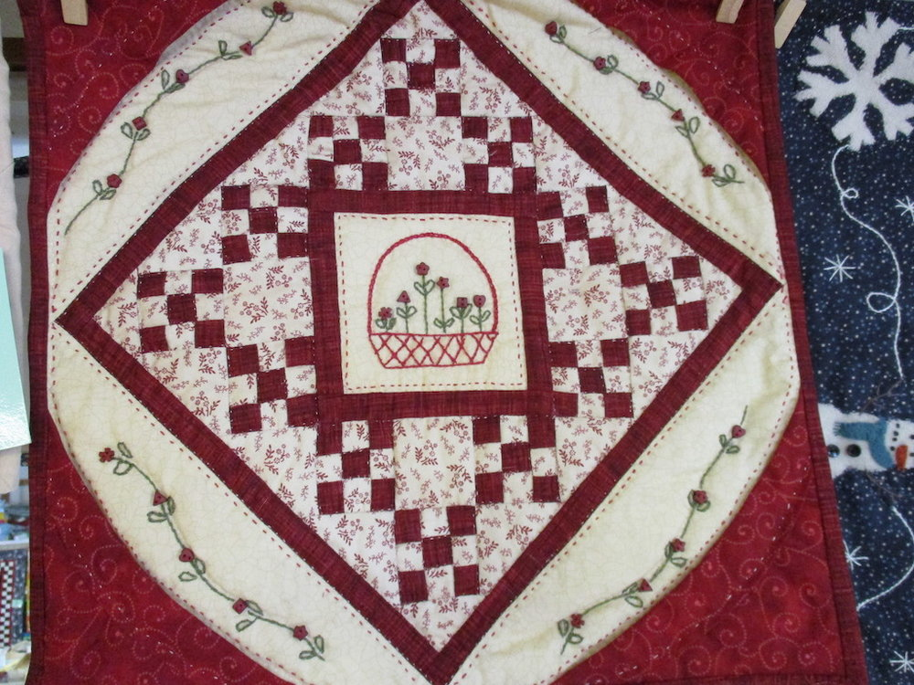 60, LITTLE RED ELEVEN (signed and dated), 14x14, Pieced and Quilted by Nancy Cordell
