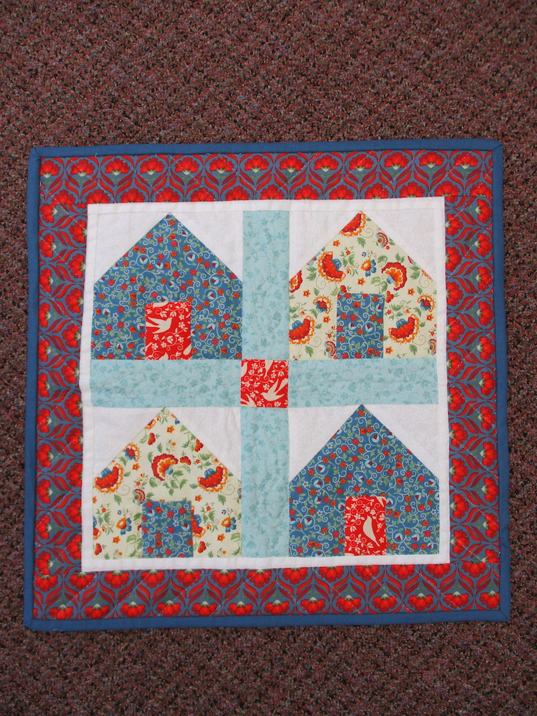64, DWELLINGS, 19x19, Pieced and Donated by Esther Swab, Quilted by MCC Volunteers