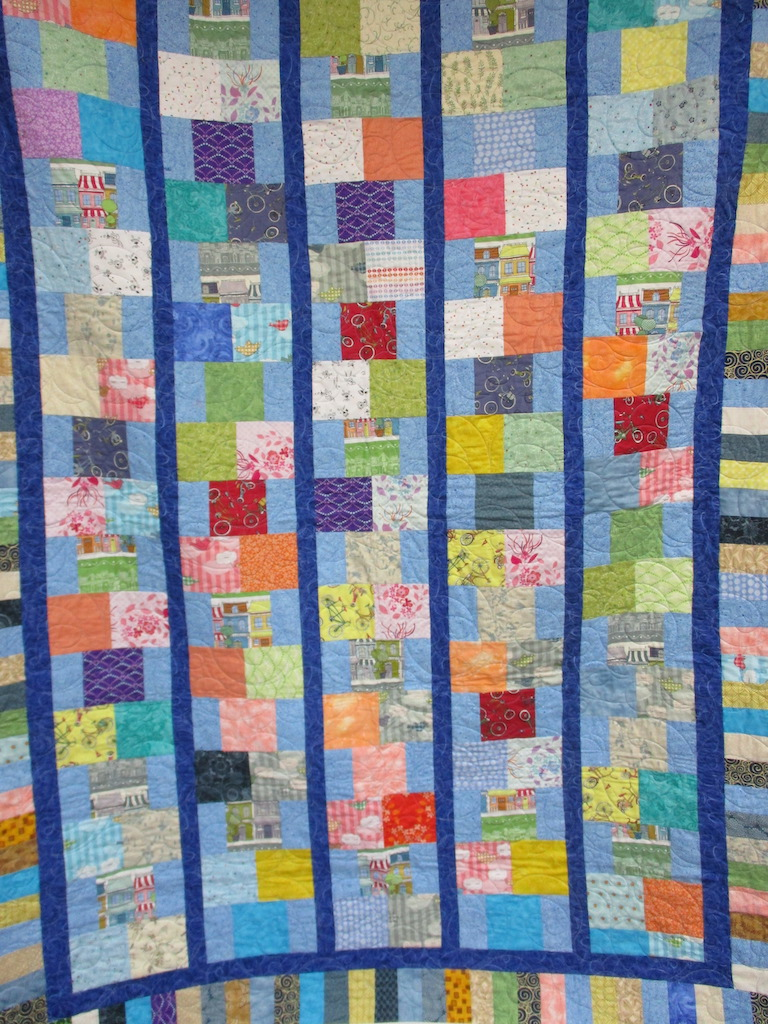 78, HOPSCOTCH (machine quilted), 62x84, Pieced, Quilted and Donated by Maureen Denis