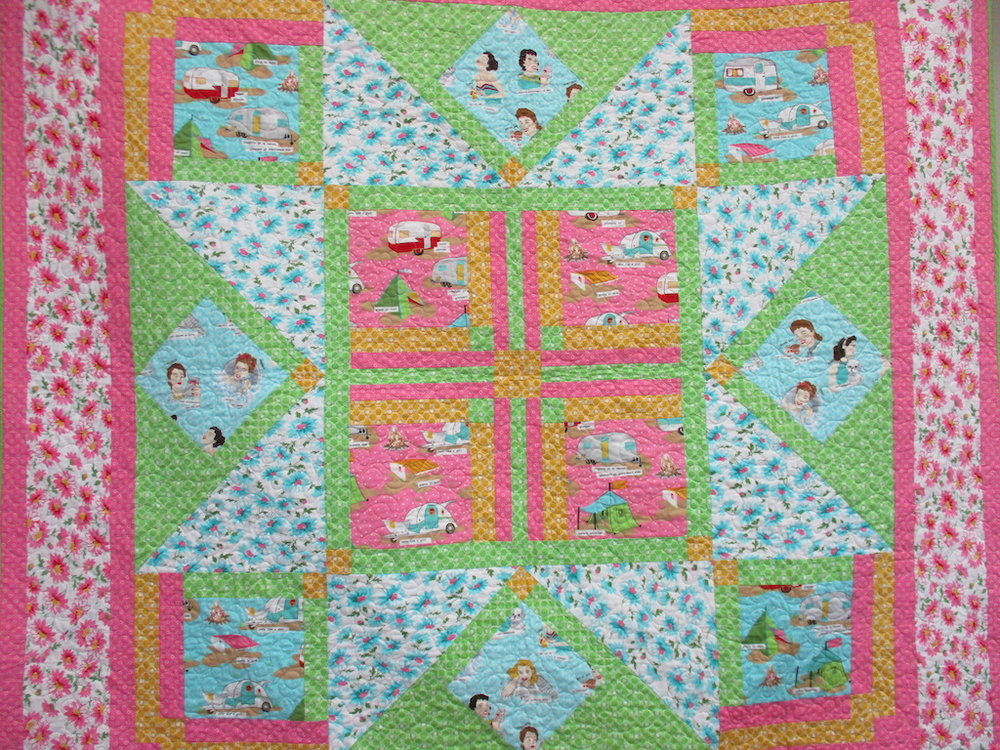 79, THE GLAMPING QUILT (machine quilted, signed and dated), 63x63, Pieced and Donated by Susan Edelman, Machine quilted by Kim Pope, Designed by Gina Gempesaw