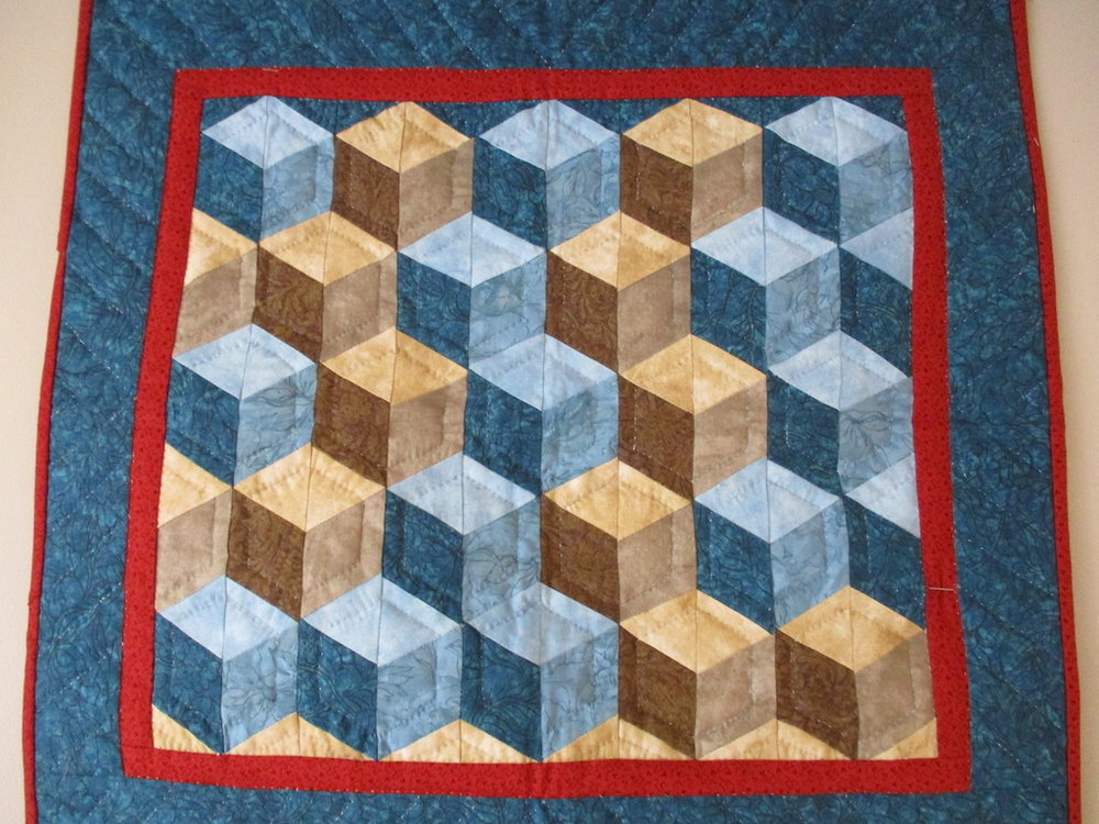 84, TUMBLING BLOCKS (signed and dated), 22x23, Pieced and Quilted by Nancy Cordell