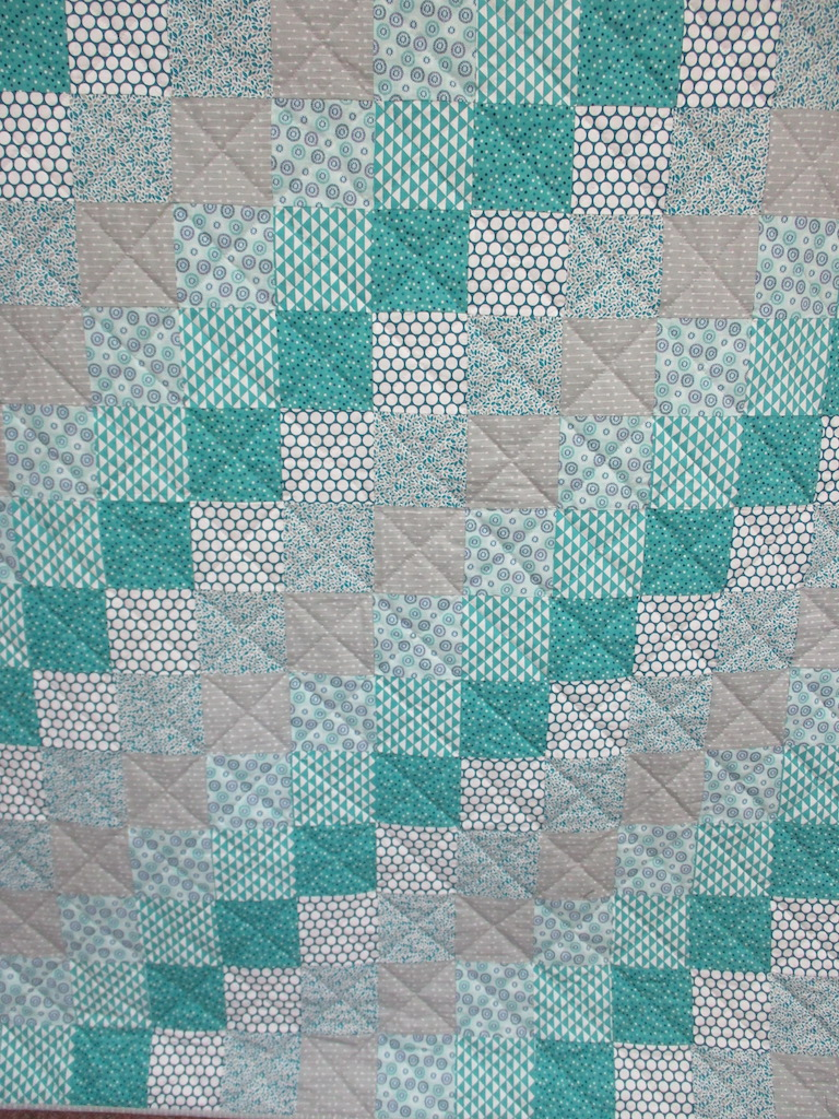 85, TEAL PATCHWORK, 60x80, Pieced and Donated by Phyllis Stuckey, Quilted by MCC volunteers