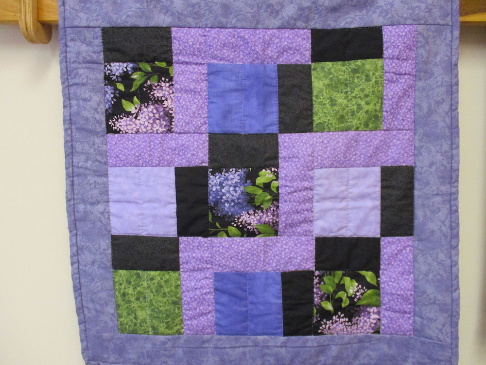 87, RAIL FENCE (signed and dated), 22x22, Pieced by Doris Yoder, Quilted by Sue Ann Sarvis