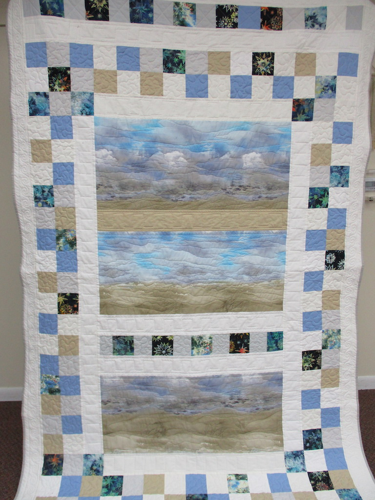 91, SERENITY I (machine quilted, signed and dated), 58x90, Pieced, Quilted and Donated by Ruth Penner