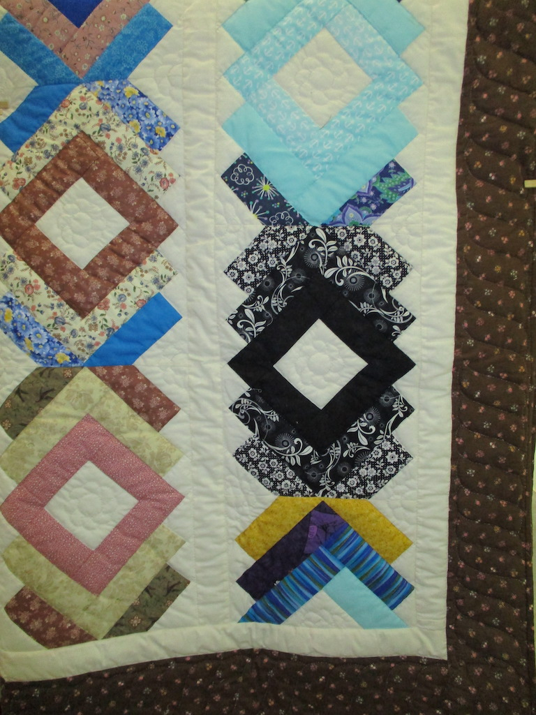 98, BRAIDWORK (signed and dated), 66x95, Pieced and Quilted by Sue Ann Sarvis