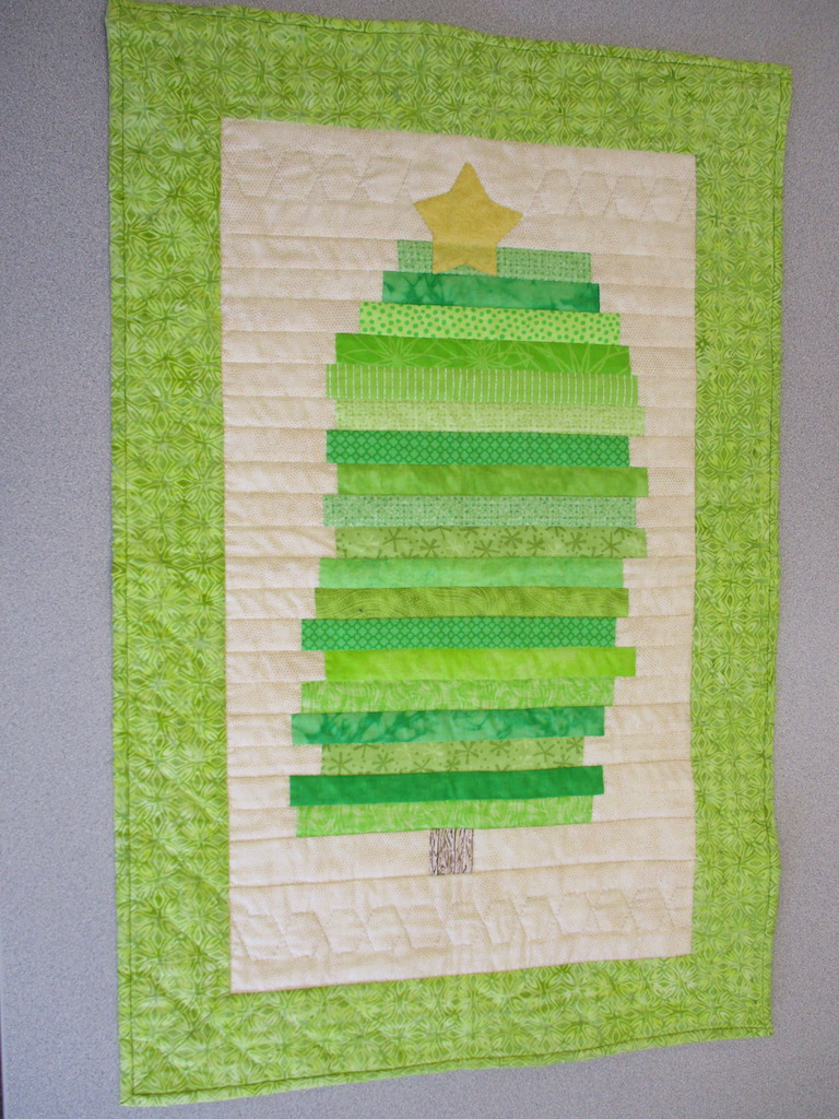 102, CHRISTMAS TREE (signed and dated), 20x32, Pieced and Donated by Cumberland Valley Relief Center, Quilted by Marie Eby