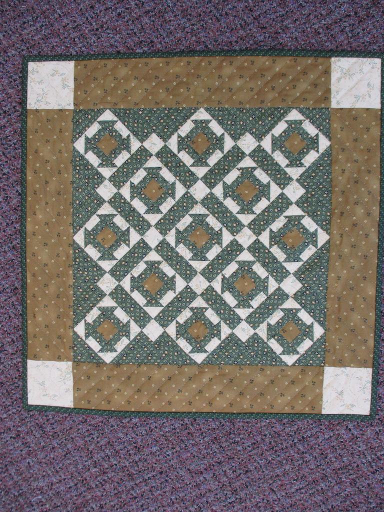124, CHURN DASH, 22x22, Pieced, Quilted and Donated by Myrna Eitzen