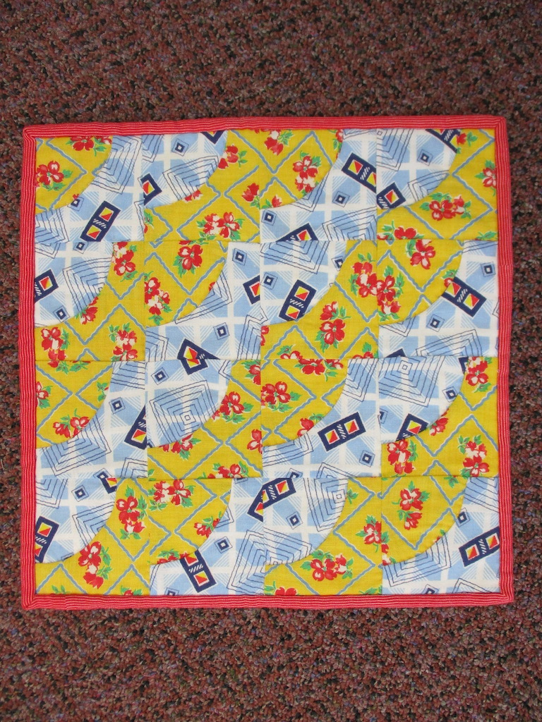 137, VINTAGE FEEDBAG DRUNKARDS' PATH (signed and dated), 13x13, Pieced, Quilted and Donated by Janet Runion Patton