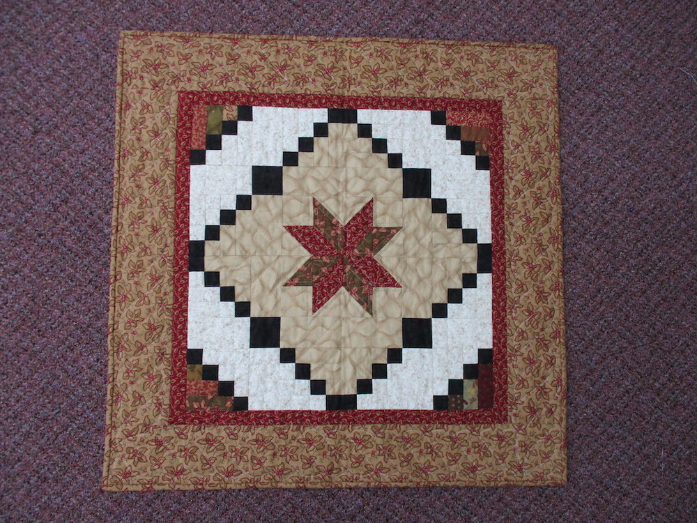 198, STAR LOG CABIN (signed and dated), 30x30, Pieced, Quilted and Donated by Mae Stoltzfus