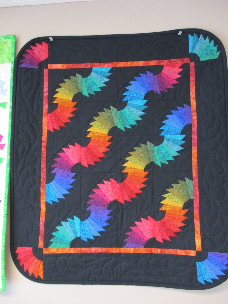 206, RAINBOW FANS (signed and dated), 26x30, Pieced by Sandi Layton, Quilted by Fannie Frey