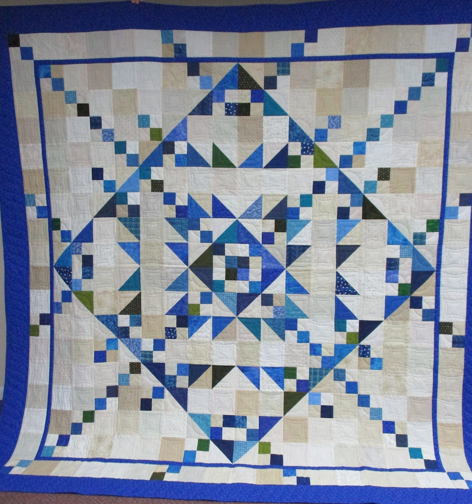 215, MY RADIANT STAR, 102x102, Pieced and Donated by Cathy Regier Irwin, Quilted by MCC Volunteers