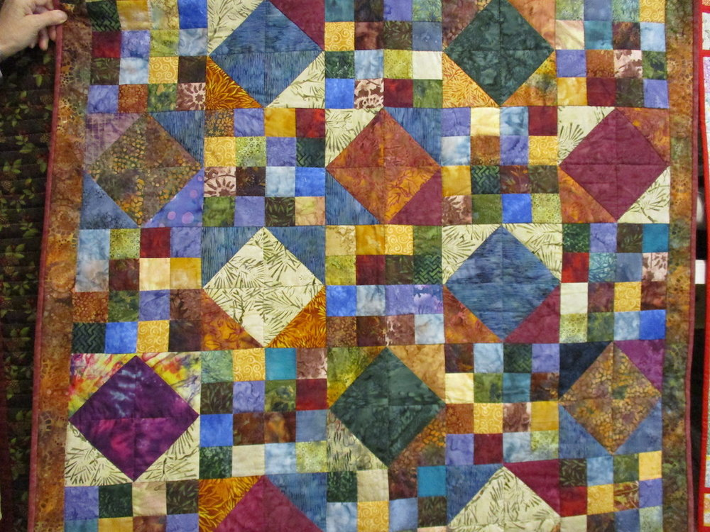 218, BATIK BEAUTY (signed and dated), 42x43, Pieced by Joan Norcross, Quilted by Fannie Frey
