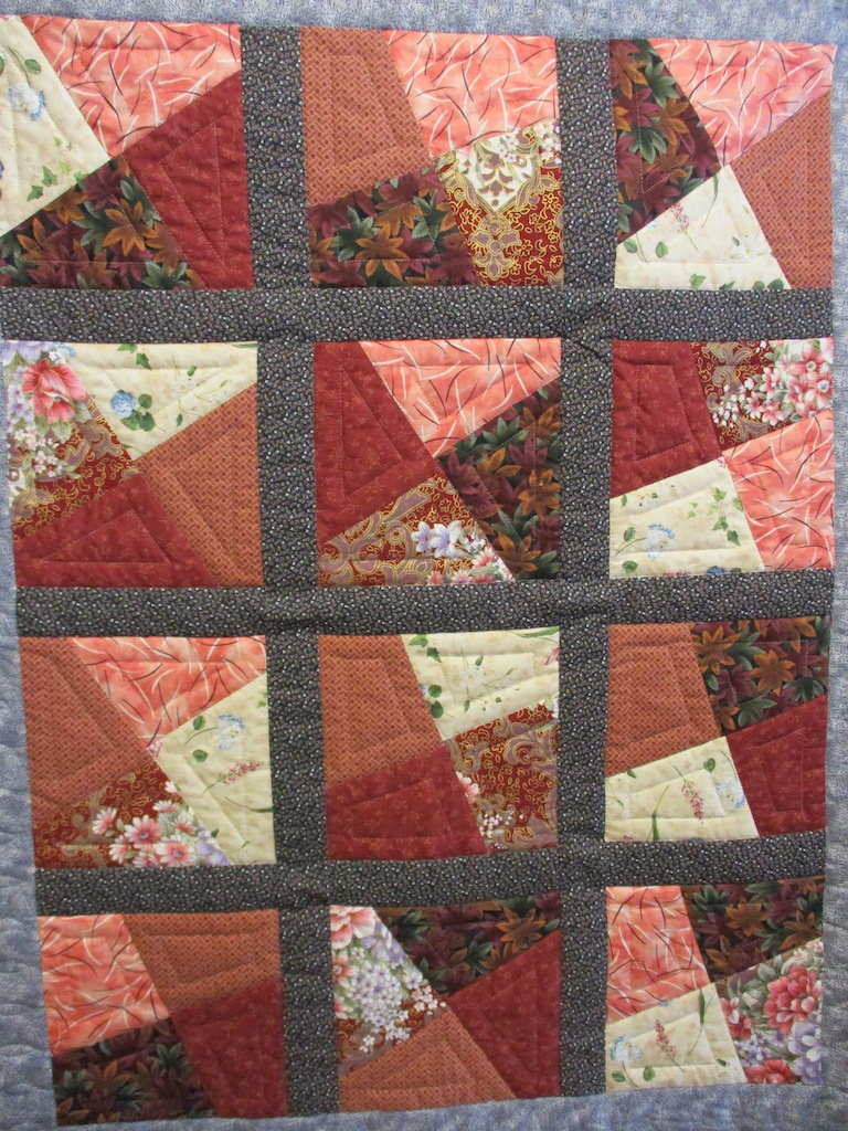 233, CRAZY PATCH (signed and dated), 38x48, Pieced by Laura Miller, Quilted by Susie DeVos