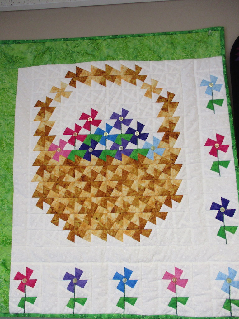 243, MAY FLOWERS WITH A TWIST (signed and dated), 28x32, Pieced and Quilted by Janet Crider